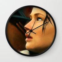 katniss Wall Clocks featuring Katniss by Kate Dunn