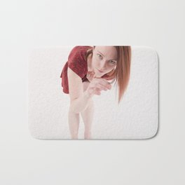 1190s-MM Model Megan in a Little Red Dress Bending Down to See Bath Mat