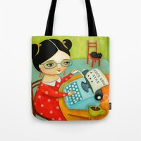 writer Tote Bags featuring The writer of stories by tascha