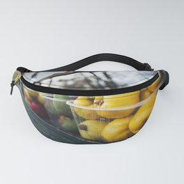 Quince on a fruit stand Fanny Pack