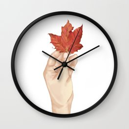 Holding the autumn Wall Clock