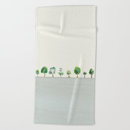 A Row Of Trees Beach Towel