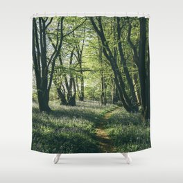 Path through Bluebells growing wild in natural woodland. Wayland Wood, Norfolk, UK. Shower Curtain