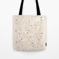 zodiac Tote Bags featuring zodiac by Kristina Nuetzmann
