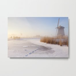 Dutch windmills in a foggy winter landscape in the morning Metal Print