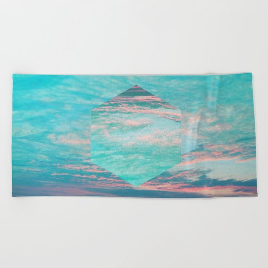 An underwater sunset Beach Towel