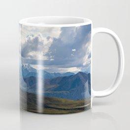 Denali peaking through the clouds Coffee Mug