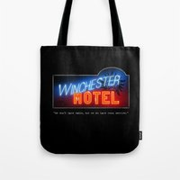 winchester Tote Bags featuring Winchester Hotel by quickreaver