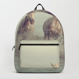 Beautiful white horses run gallop in the water at sunset light Backpack