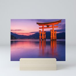 Wonderful sunset colors at the famous floating Torii Gate on Miyagima Island, Japan. Mini Art Print