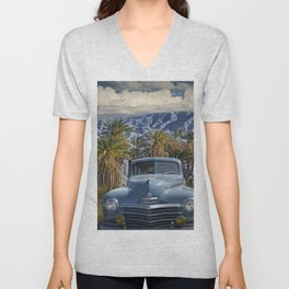Vintage Blue Plymouth Automobile against Palm Trees and Cloudy Blue Sky near Palm Springs California Unisex V-Neck