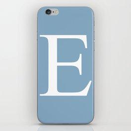 Letter E sign on placid blue color background iPhone Skin