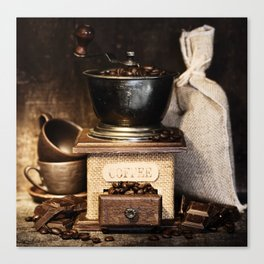 Still life with Antique coffee grinder, burlap sack, coffee cups and chocolate on  rustic table Canvas Print