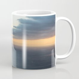 Dramatic sky and beautiful sunset over Atlantic ocean in Madeira island, Portugal. Coffee Mug