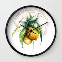 lemon Wall Clocks featuring Lemon by Alejandra Lara