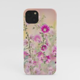 Pink and red Hollyhock flowers blooming in the garden iPhone Case
