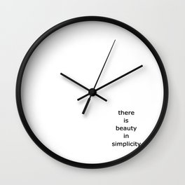 there is beaty in simplicity Wall Clock