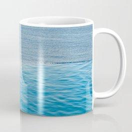Empty infinity pool on the sunset, quiet bue sea Coffee Mug