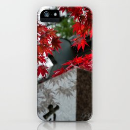 Red leaves in Japan cemetery iPhone Case