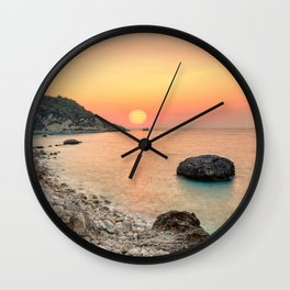 The sunset at the famous village Agios Nikitas in Lefkada, Greece Wall Clock