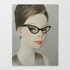Young woman wearing retro cat eye glasses Canvas Print