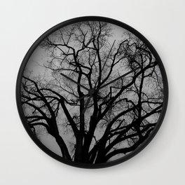 Tree in the dark Wall Clock