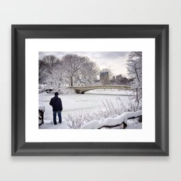 A man looking out over a frozen lake in New York City's Central Park on a winter day Framed Art Print