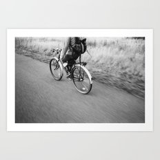 bicycle in motion Art Print