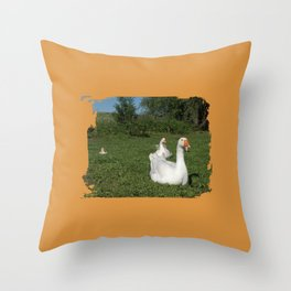 meadow two white geese with their young on the green Throw Pillow