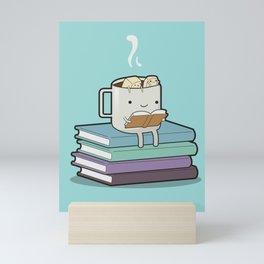 A hot cup and a good book Mini Art Print