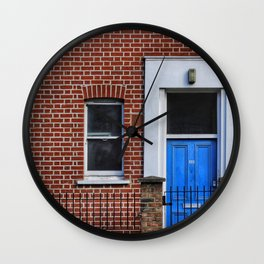 RED BRICK BUILDING WITH CLOSED DOOR AND WINDOW Wall Clock