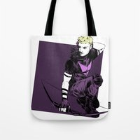 clint barton Tote Bags featuring Clint Barton by The Radioactive Peach