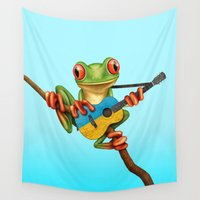 ukraine Wall Tapestries featuring Tree Frog Playing Acoustic Guitar with Flag of Ukraine by Jeff Bartels