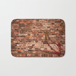 Red ivy hedge climber on wall Bath Mat