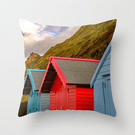 Trio of traditional beach huts Throw Pillow