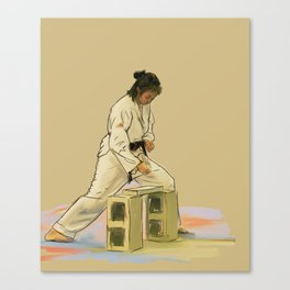 Preparing to Break a Brick Canvas Print