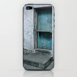 What's behind the old blue door? iPhone Skin