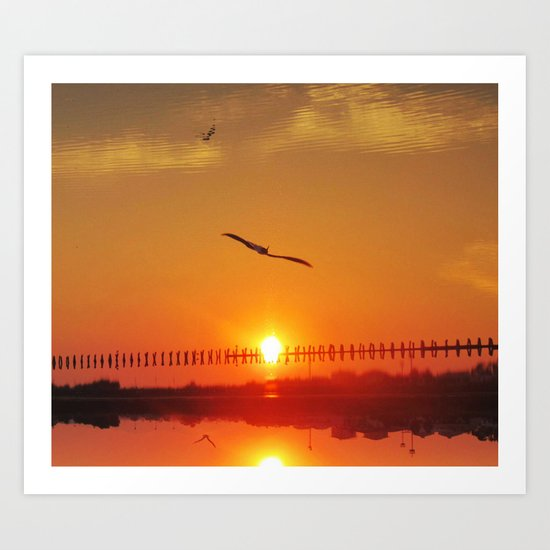sunset in reverse. - the sea becomes the sky Art Print