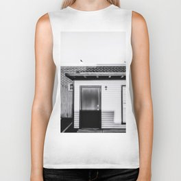 wood building with brick building background in black and white Biker Tank
