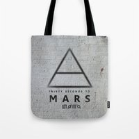 30 seconds to mars Tote Bags featuring 30 Seconds to Mars - stencil on brick wall by sky0323