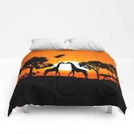 Giraffe silhouettes at sunset Comforters
