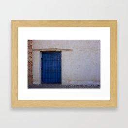 The old blue door Framed Art Print