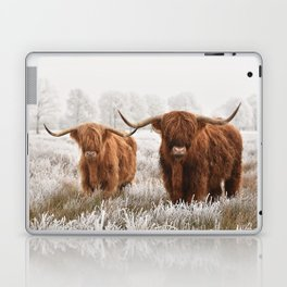 Hairy Scottish highlanders in a natural winter landscape. Laptop & iPad Skin