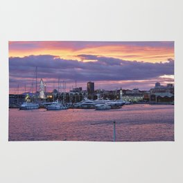 Sunset at the seaport Rug