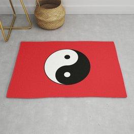 Yin and yang Symbol on red Rug