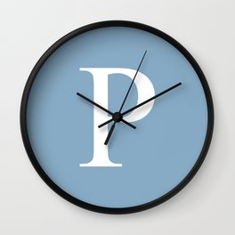 Letter P sign on placid blue background Wall Clock