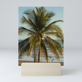 view of a palm tree at the pacific ocean Mini Art Print