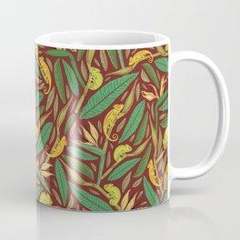 Green chameleon on strelitza amoung palm leaves on maroon background Coffee Mug