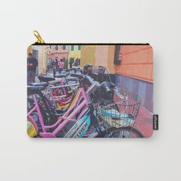 Lined bicycles, red wall, and brown arch Carry-All Pouch
