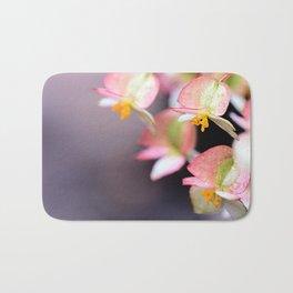 Raindrops on Tiny Begonia Blooms Bath Mat